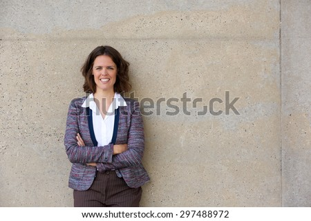 Portrait of a confident business woman smiling with arms crossed - stock photo