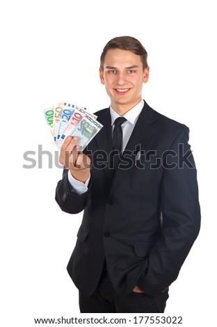 Portrait of a confident businessman holding a money after a deal - stock photo
