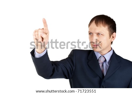 Portrait of a confident businessman pushing an imaginary button, over white background - stock photo