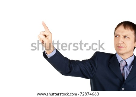 Portrait of a confident businessman pushing on invisible touch screen, over white background - stock photo