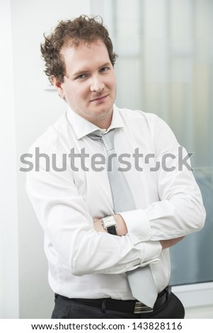 Portrait of a confident businessman standing in office