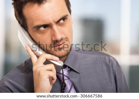 Portrait of a confident businessman talking on the phone