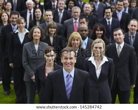 Portrait of a confident businessman with multiethnic team