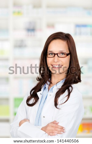 Portrait of a confident female pharmacist standing in drugstore - stock photo