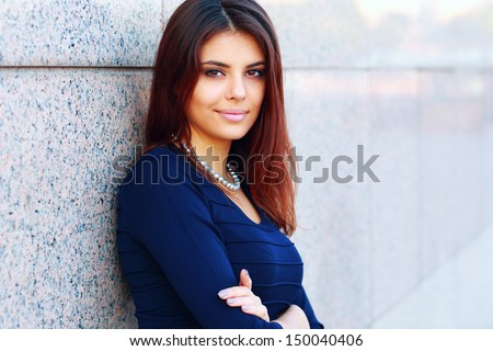 Portrait of a confident happy businesswoman - stock photo