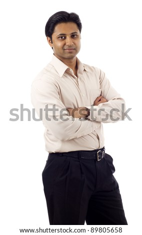 Portrait of a confident Indian business man with hands folded isolated over white background - stock photo