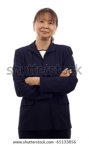 Portrait of a confident senior Asian business woman with arms folded isolated over white background - stock photo