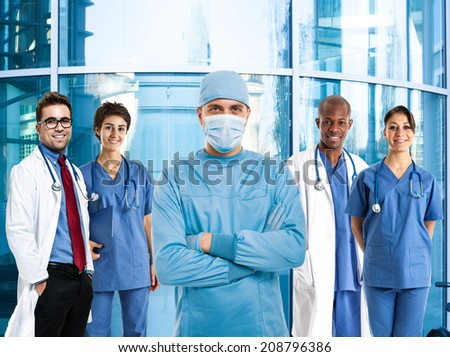 Portrait of a confident surgeon in front of a group of doctors
