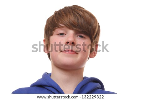 Portrait of a confident young boy on white background