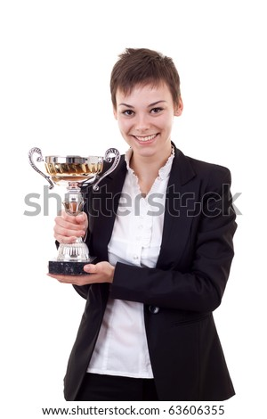 Portrait of a confident young business woman holding a silver cup against white background