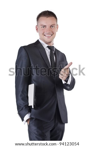 Portrait of a confident young businessman standing isolated on white background