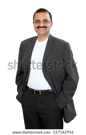 Portrait of a confident young indian business man standing - stock photo