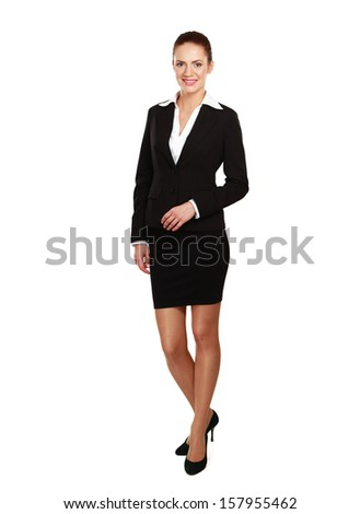 Portrait of a confident young woman standing isolated on white background - stock photo