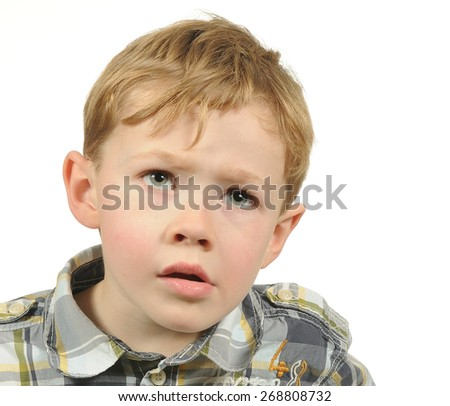 Portrait of a Confused Little Boy - stock photo