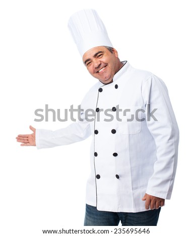 portrait of a cook man doing a welcome gesture - stock photo