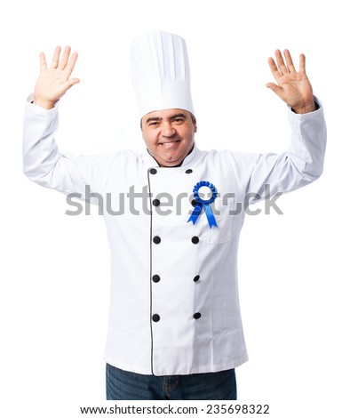 portrait of a cook man wearing an insignia - stock photo