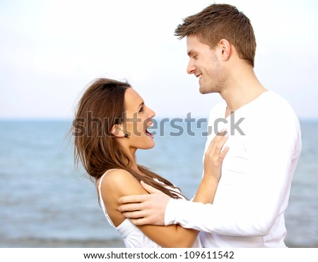 Portrait of a couple enjoying each other's company at the beach - stock photo