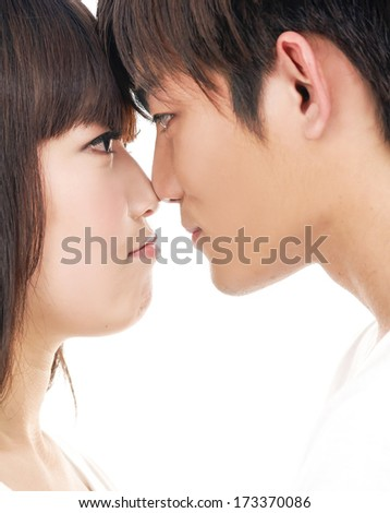 portrait of a couple in love, isolated on white - stock photo