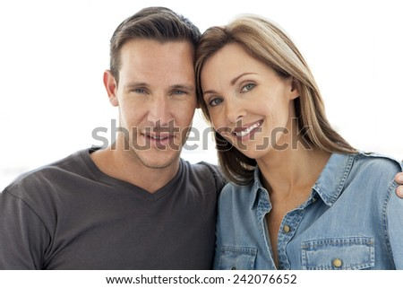 Portrait of a couple in love isolated on white - stock photo