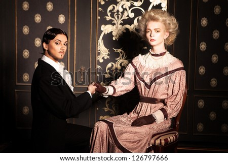 Portrait of a couple in old-fashioned style, couple switched the roles - stock photo