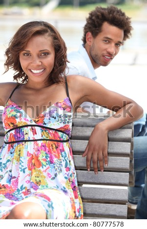 portrait of a couple on a bench - stock photo