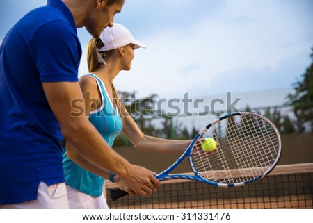 Portrait of a couple playing in tennis - stock photo