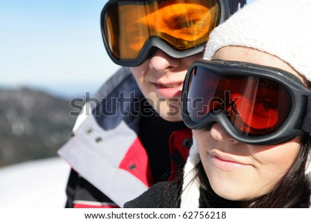 Portrait of a couple wearing a mask of ski - stock photo