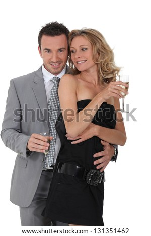 portrait of a couple with champagne - stock photo