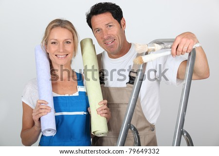 portrait of a couple with wallpaper - stock photo