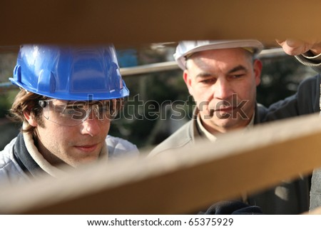 Portrait of a craftsman and an apprentice - stock photo