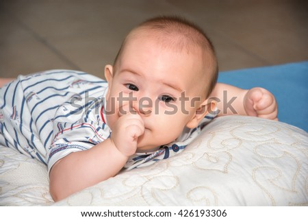 Portrait of a crawling baby in room - stock photo