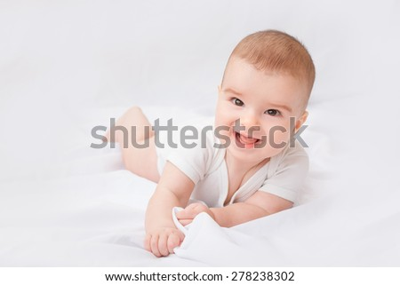 Portrait of a crawling baby on the bed - stock photo