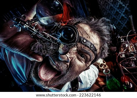 Portrait of a crazy medieval scientist working in his laboratory. Alchemist. Halloween. - stock photo