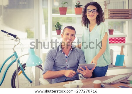 Portrait of a creative business colleagues using a digital tablet - stock photo