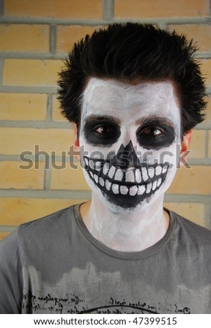 portrait of a creepy skeleton guy perfect for Carnival (brick wall background) - stock photo
