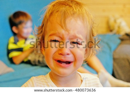 portrait of a crying baby in the room
