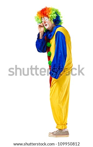 Portrait of a crying clown. Isolated over white background - stock photo