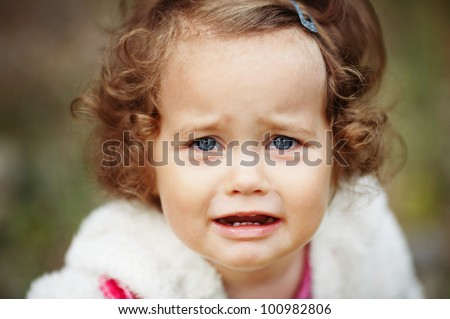 portrait of a crying little girl - stock photo