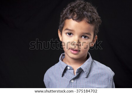 Portrait of a cute african american little boy, isolated on black - stock photo