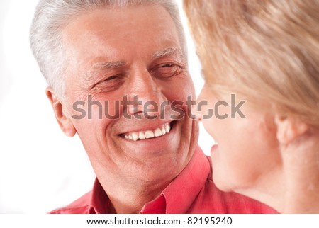 portrait of a cute aged couple on white