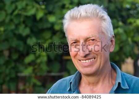 portrait of a cute aged man at nature
