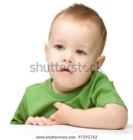 Portrait of a cute and pensive little boy, isolated over white - stock photo