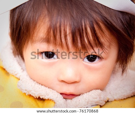 Portrait of a cute asian baby . - stock photo