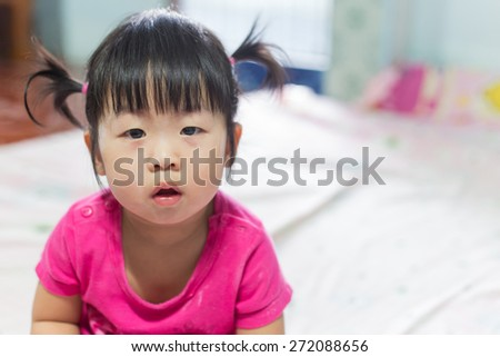 Portrait of a cute Asian child girl and looking aside - stock photo