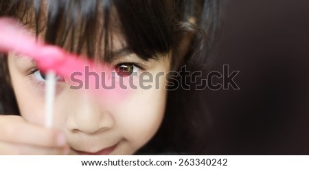Portrait of a cute asian girl playing  wind turbine toy , Shallow depth of field composition. - stock photo