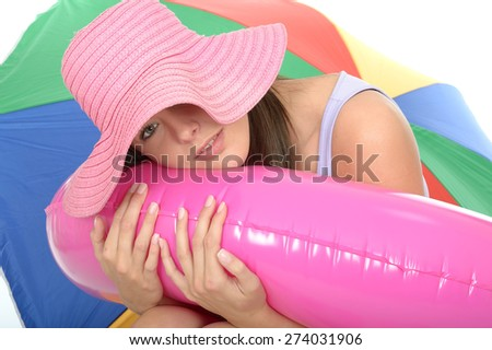 Portrait of a Cute Attractive Young Woman in Her Twenties Wearing a Pink Straw Sun Hat Relaxing and Smiling - stock photo