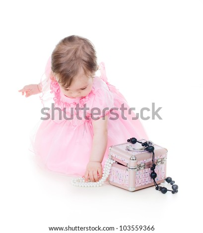 portrait of a cute baby girl with a box with jewelry - stock photo