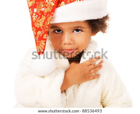 Portrait of a cute baby in Christmas hat and fur on white background - stock photo