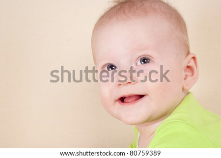 portrait of a cute baby  lying on sofa