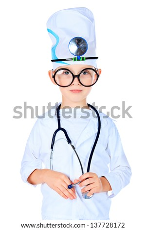 Portrait of a cute boy in big spectacles playing doctor with a stethoscope. Isolated over white. - stock photo